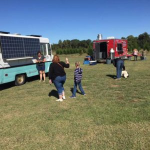 Food trucks with visitors eating and relaxing.