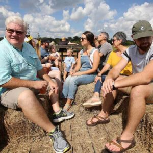 Visitors relaxing on hayride.