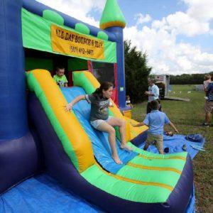 Children having fun in bounce house.