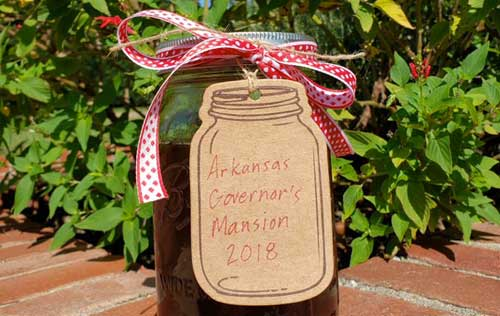 Jar of honey labeled 'Arkansas Governor's Mansion 2018'.